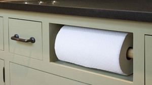 A paper towel roll set in the fake sink drawer or in the case of most trailers, right under the sink.